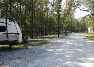 Several RVs nestled in the woods. Hard to see them all? Indeed, a sense of privacy.